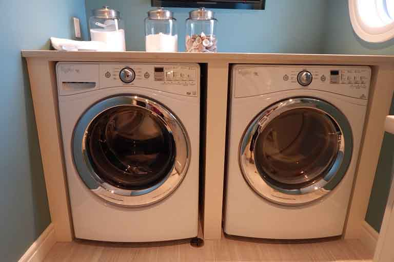 two white laundry machine